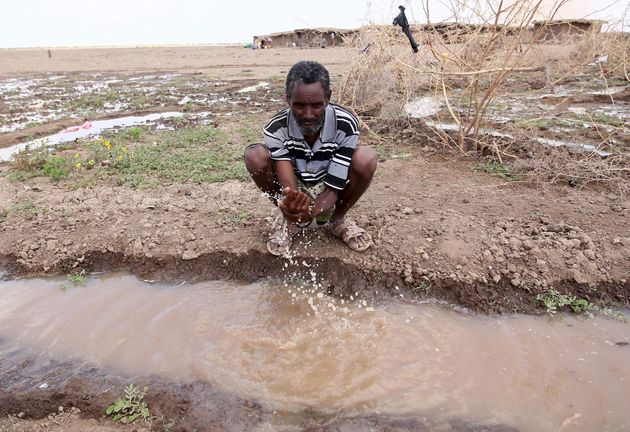 A man washes his hand in a trench in a drought-stricken region of Ethiopia in January