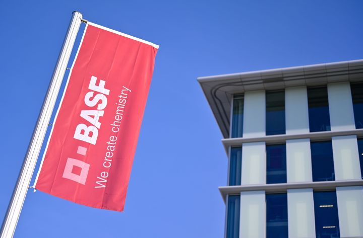A flag with the logo of German firm BASF flutters at the company's headquarters in Ludwigshafen, Germany, Feb. 26, 2019. The petrochemical giant is considered a bellwether of the global economy.