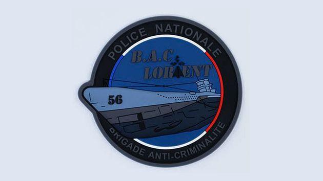 Cet emblème de la Brigade anti-criminalité de Lorient représente un sous-marin de...