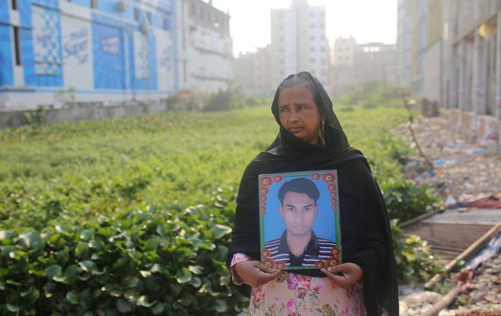 A woman holds a picture of a relative who went missing in the Rana Plaza building collapse, on the tragedy's sixth anniversary in Dhaka, Bangladesh, April 24, 2019.