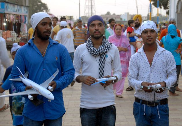 Devotees carry model aircraft to offer at a Sikh temple in Jalandhar, also known as 'Hawai Jahaaz Gurdwara'...