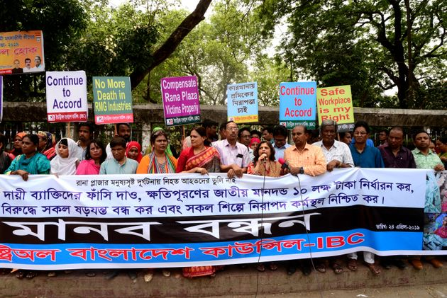 Activists protest to demand safe workplaces for garment workers at an event to mark the sixth anniversary...