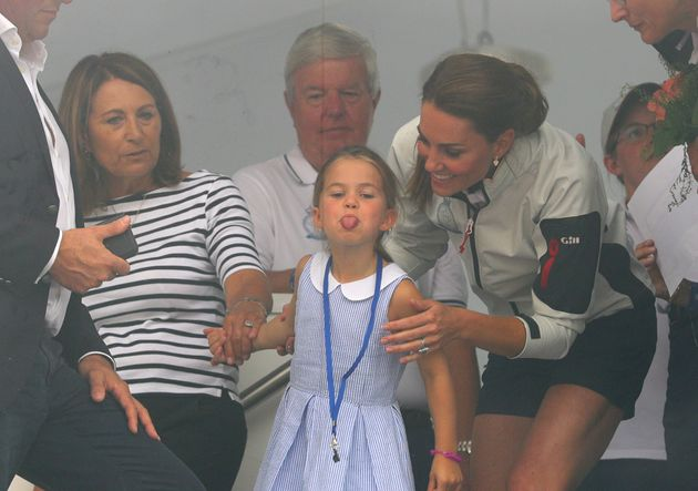 The Duchess of Cambridge -- with Charlotte and Carole Middleton -- look through a window at the prize...