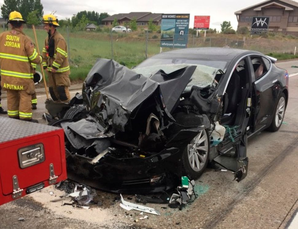 In May 2018, a Tesla rammed into a police truck stopped at a red light in South Jordan, Utah. The driver...