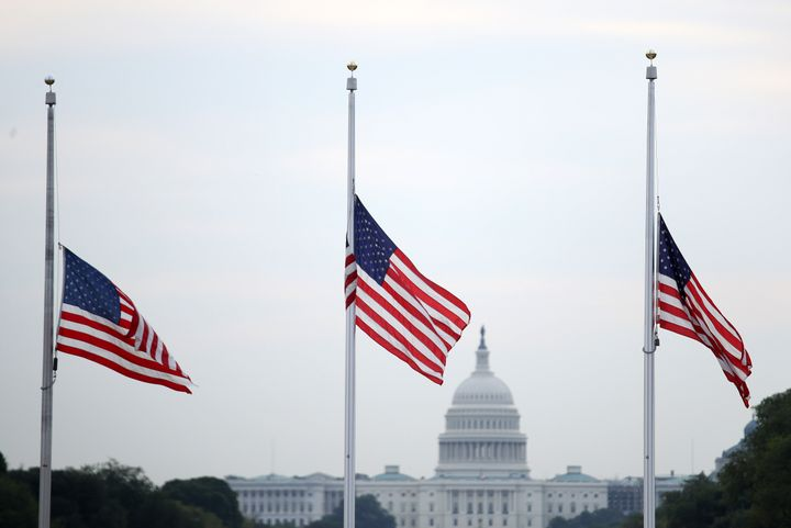 Flags fly at half-staff in Washington after more than 30 people died in mass shootings.