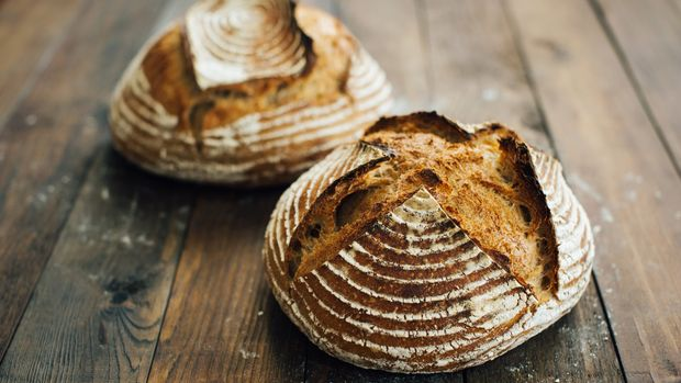 homemade artisan bread on vintage wooden background.