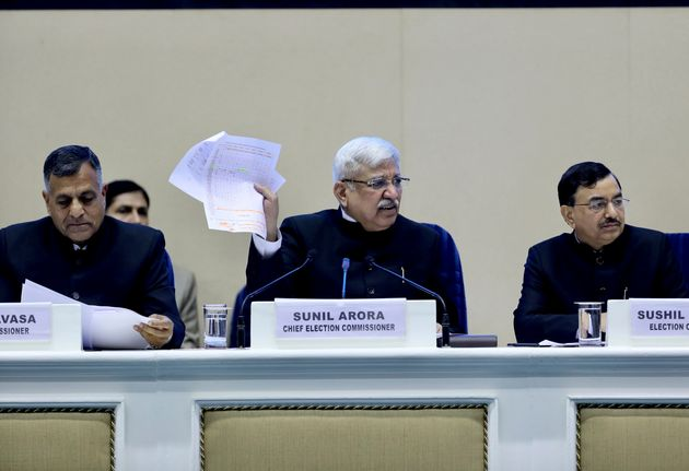 Chief Election Commissioner Sunil Arora, center, speaks during a press conference in New Delhi, March...