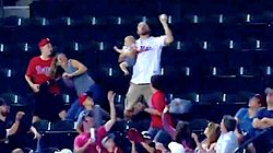 Man Holding Baby Makes Slick One-Handed Catch Of Foul Ball At MLB