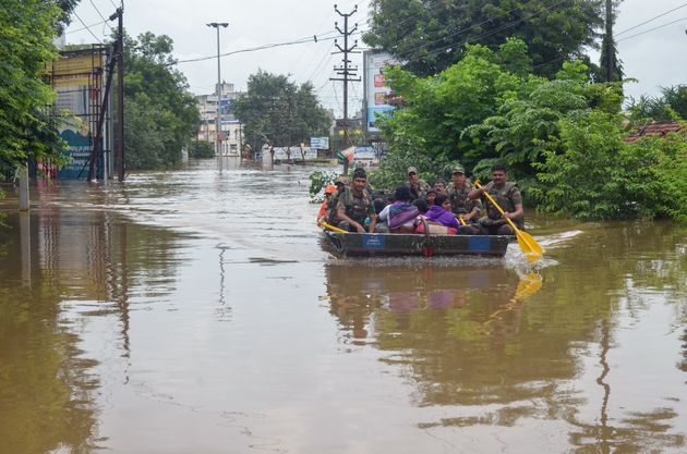 In this photograph taken on August 8, 2019, Indian Army personnel rescue people stranded in flood waters...