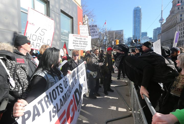Far-right demonstrators and counterprotesters in Toronto in March 2019.
