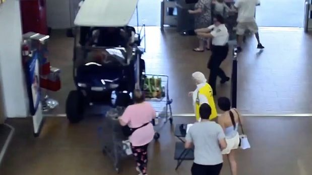 man crashes golf cart into Walmart