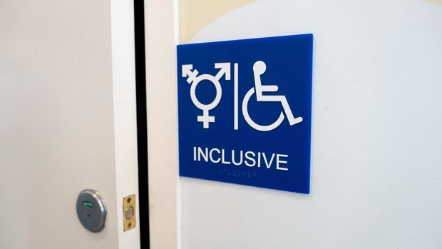 Sign for inclusive restroom, with symbol indicating male, female and transgender as well as handicapped symbol, part of LGBT rights initiatives in the Mission District neighborhood of San Francisco, California, July 18, 2019. (Photo by Smith Collection/Gado/Getty Images)