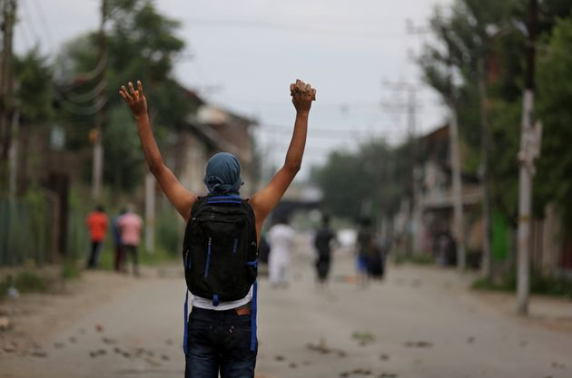 A Kashmiri protester shouts slogans during a protest in Srinagar on