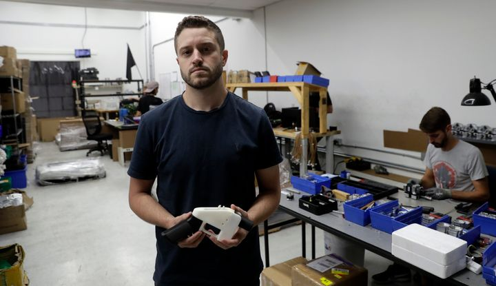 Cody Wilson and his fully 3D-printed gun.