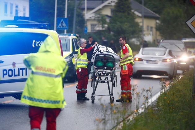 Emergency crews are seen near a stretcher after a shooting in al-Noor Islamic center mosque, near Oslo,...
