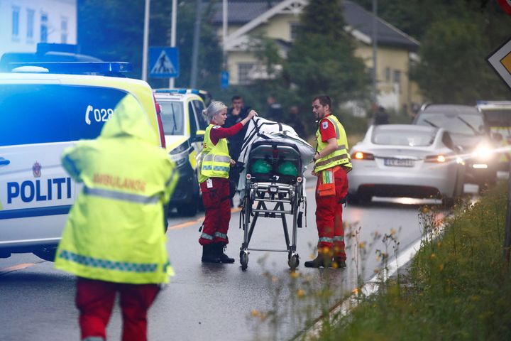 Emergency crews are seen near a stretcher after a shooting in al-Noor Islamic center mosque, near Oslo, Norway August 10, 201
