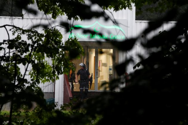 Police officers walk out of al-Noor Islamic center mosque after a shooting, near Oslo, Norway August...