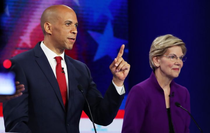 Sens. Cory Booker (D-N.J.) and Elizabeth Warren (D-Mass.) are among the 2020 presidential candidates to call for a national g
