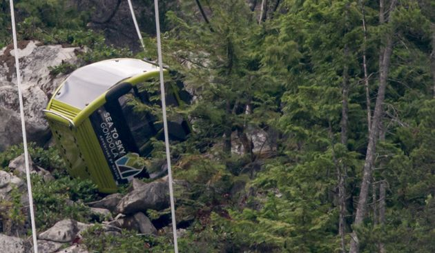 A gondola car rests on its side on the mountain after a cable snapped overnight at the Sea to Sky Gondola...