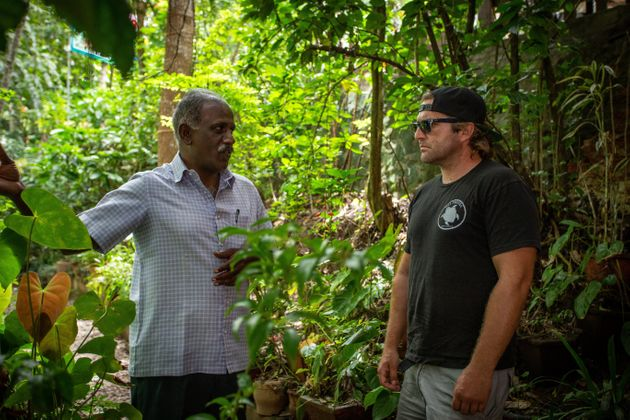 Nik Erickson of Fullmoon Farms, a Flower Co Supplier, speaks with a Kerala farmer to understand the cultivation...