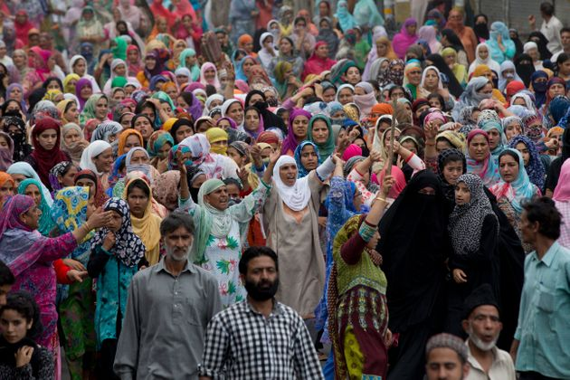 In this Friday, Aug. 9, 2019, photo, Kashmiri women shout slogans during a protest march in Srinagar,