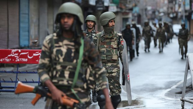 Indian paramilitary soldiers patrol a street in Srinagar, Indian controlled Kashmir, Saturday, Aug. 10, 2019. Authorities enforcing a strict curfew in Indian-administered Kashmir will bring in trucks of essential supplies for an Islamic festival next week, as the divided Himalayan region remained in a lockdown following India's decision to strip it of its constitutional autonomy. The indefinite 24-hour curfew was briefly eased on Friday for weekly Muslim prayers in some parts of Srinagar, the region's main city, but thousands of residents are still forced to stay indoors with shops and most health clinics closed. All communications and the internet remain cut off. (AP Photo/Mukhtar Khan)