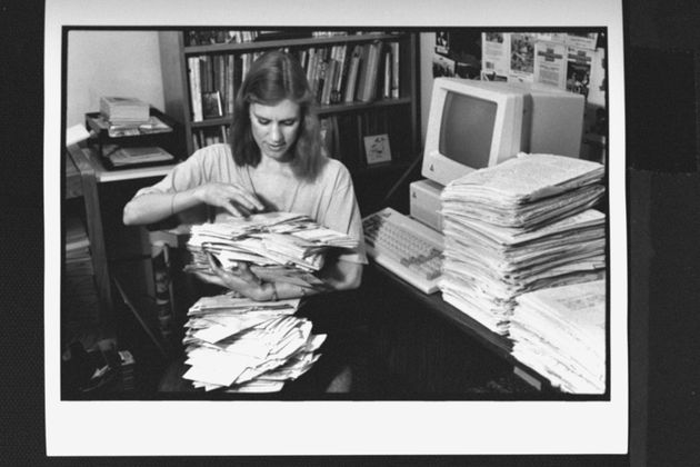 Ann M. Martin sorts through stacks of fan mail at home in Greenwich Village in the late