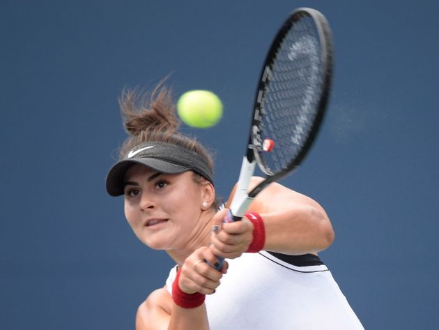 Canada's Bianca Andreescu returns to Serena Williams, of the United States, during the final of the Rogers...