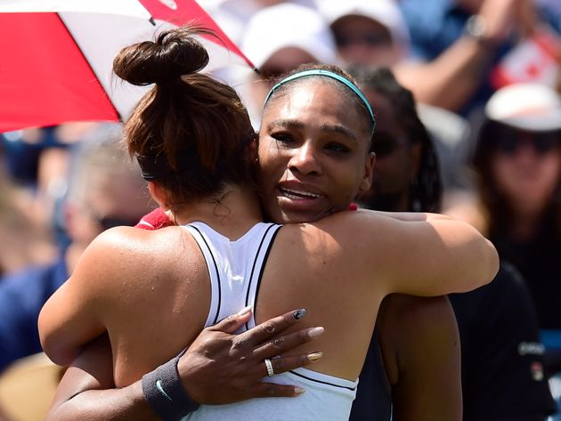 Canada's Bianca Andreescu, left, consoles Serena Williams, of the United States, after Williams had to...
