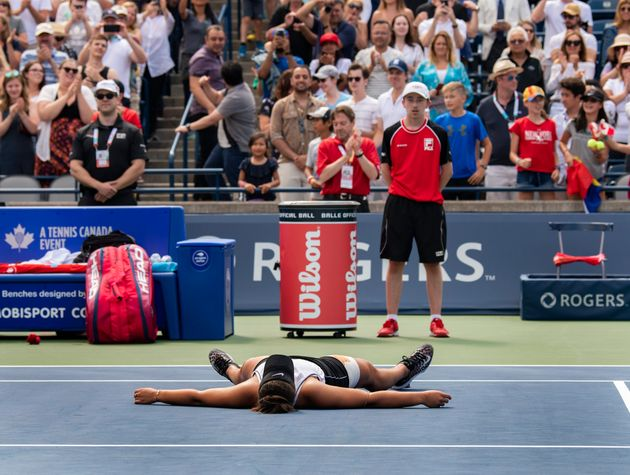 Bianca Andreescu lies on the court after her semifinal win at the Rogers Cup in Toronto on Aug....