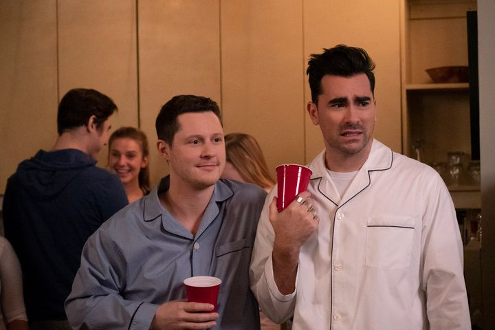 "Noah Reid, left, and Dan Levy, right, as Patrick Brewer and David Rose in season five of ""Schitt's Creek."""