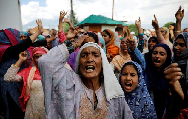 Kashmiri women shout slogans during a protest after the scrapping of the special constitutional status...