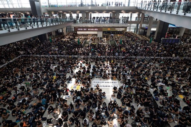 Thousands of protesters filled up the arrival hall of the Hong Kong International Airport on Monday during...