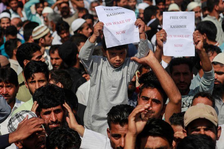 Kashmiris attend a protest in Srinagar on 12 August.