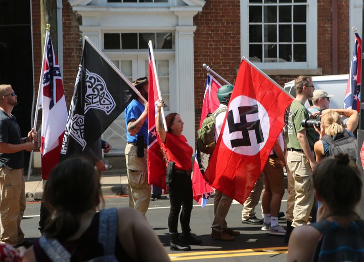"A Nazi flag flies during the ""Unite the Right"" white supremacist rally in Charlottesville, Virginia, on Aug. 12,"