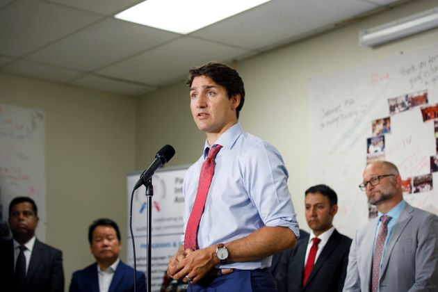 Prime Minister Justin Trudeau speaks during a press conference at the Parkdale Intercultural...