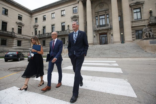 Manitoba Premier Brian Pallister, with Olivia Billson, PC Press Secretary and Fred Meier, clerk of the...