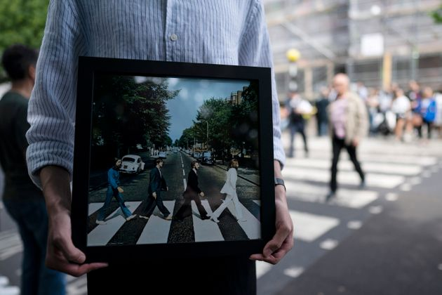 A fan holds the cover of The Beatles'