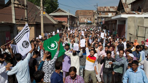 "Kashmiri Muslims shout slogans during a protest after Eid prayers during a security lockdown in Srinagar, Indian controlled Kashmir, Monday, Aug. 12, 2019. Hundreds of worshippers gathered after the prayers and chanted ""We want freedom"" and ""Go India, Go back,"" witnesses said. Officials said the protest ended peacefully. (AP Photo/ Dar Yasin)"