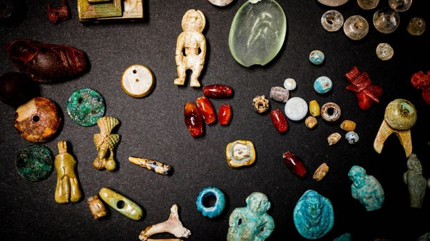 Some of the beads, amulets and charms that were found at Pompeii - REX