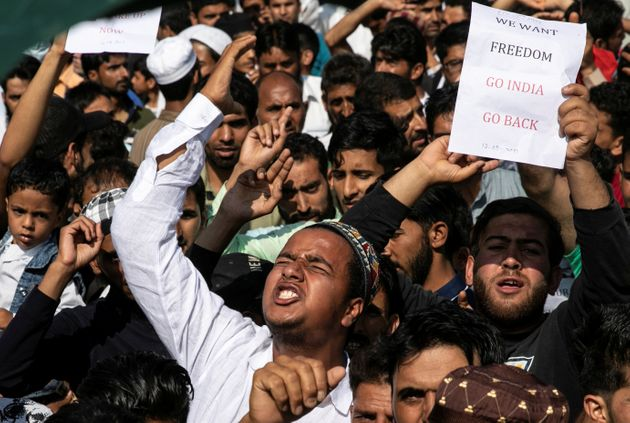 Kashmiris attend a protest after Eid-al-Adha prayers at a mosque during restrictions after the scrapping...
