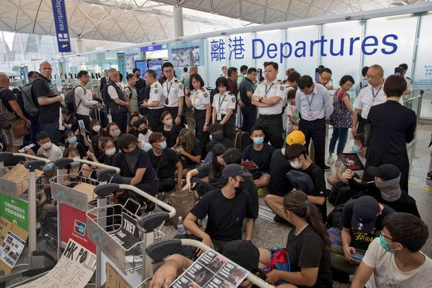 Protesters stage a sit-in protest in the departures area of Hong Kong's international airport on