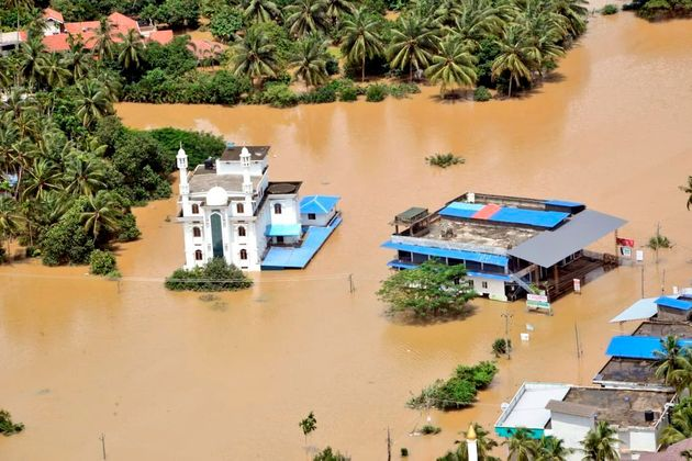 This Aug. 11, 2019 photograph released by Indian Navy shows a flooded area of Malappuram district...