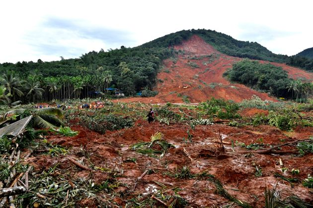This photograph provided by the All India Congress Committee, shows a landslide site in Kavalappara,...