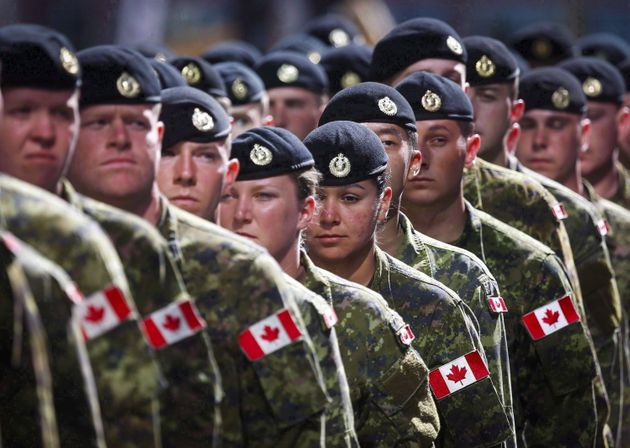 Members of the Canadian Armed Forces march during the Calgary Stampede parade in Calgary on July 8,