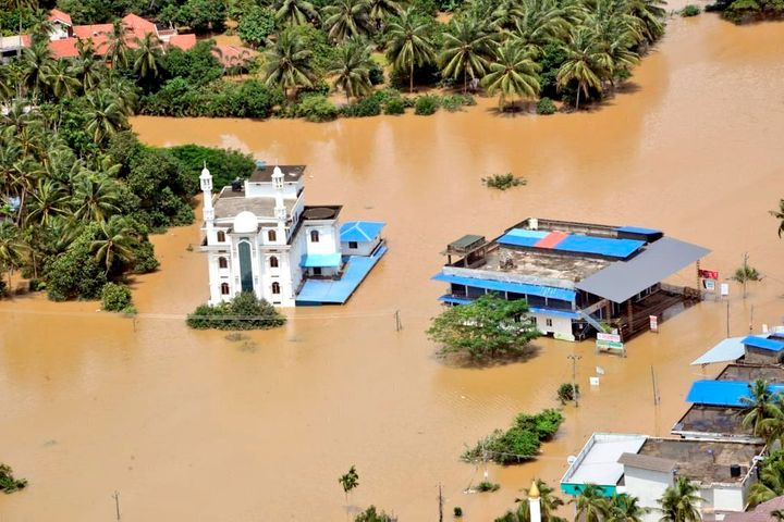 A photograph released by Indian Navy on 11 August shows a flooded area of Malappuram district, Kerala.