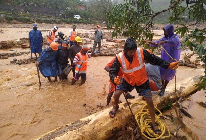 NDRF personnel help move flood victims to safer areas in Wayanad district, Kerala.