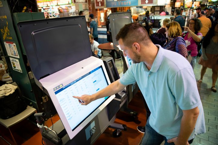 Steve Marcinkus, an Investigator with the Office of the City Commissioners, demonstrates the ExpressVote XL voting machine at