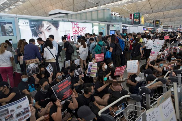 Hong Kong Protesters Take Suspected Undercover Police Officer Hostage During Violent Stand-Off Inside Airport
