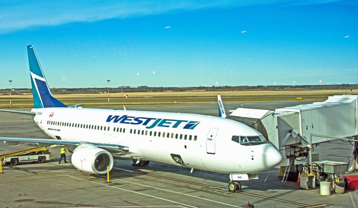A WestJet Boeing 737 unloading at a gate in Edmonton, Oct. 18, 2015.